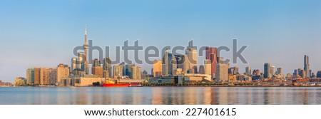Panorama of Toronto over Ontario Lake at sunrise - stock photo