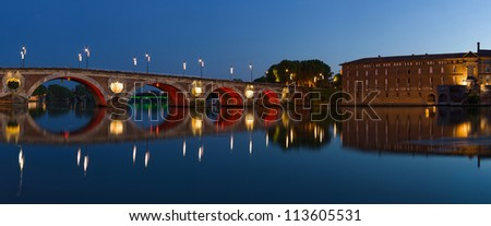 Panorama of Toulouse city center: New Bridge (Pont Neuf) and City Hotel (Hotel de VIlle) - stock photo