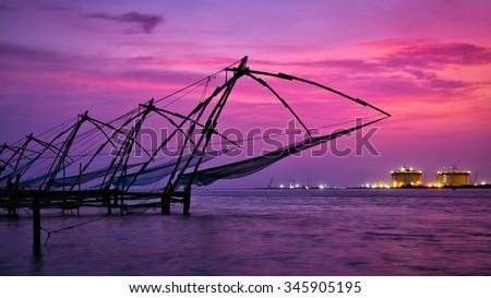 Panorama of tourist attraction of Kochi - chinese fishnets on sunset. Fort Kochin, Kochi, Kerala, India - stock photo