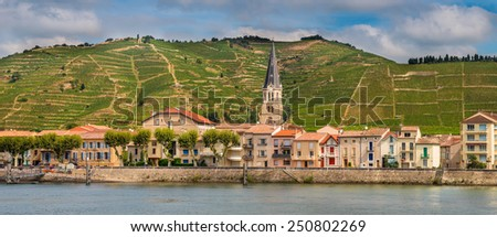 Panorama of Tournon sur Rhone river town and Vineyards on the Hills of the Cote du Rhone Area in France - stock photo