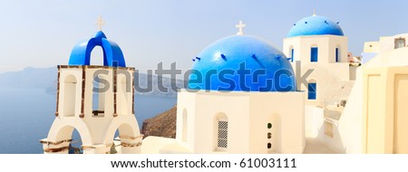 Panorama of traditional blue and white church closeup in Santorini Greece - stock photo