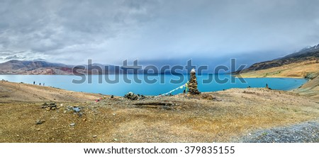 Panorama of Tso the Moriri lake near Karzok village in Rupshu valley against the background of cloudly sky - Tibet, Leh district, Ladakh, Himalayas, Jammu and Kashmir, Northern India - stock photo