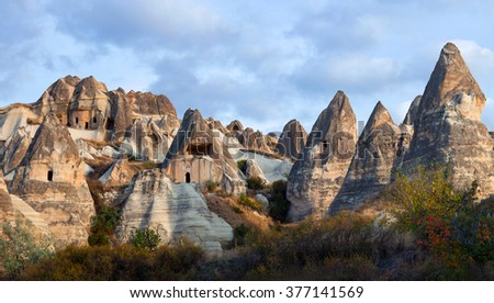 Panorama of unique geological formations in Cappadocia, Turkey. Cappadocian Region with its valley, canyon, hills located between the volcanic mountains Erciyes, Melendiz and Hasan. - stock photo