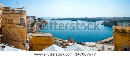 Panorama of Valletta bay, Malta, with parts of castle and blue sea - stock photo