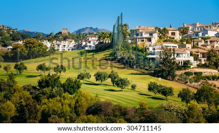 Panorama of Village With Whitewashed Houses In Benahavis, Malaga, Andalusia, Spain. Summer Cityscape. Sunny Day With Good Weather and Clear Blue Sky - stock photo