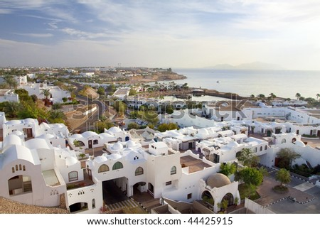 Panorama of white city and the blue sea with a coast line Sharm el-Sheikh - stock photo
