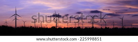 Panorama of Wind turbine power generator at twilight ( renewable energy source) - stock photo
