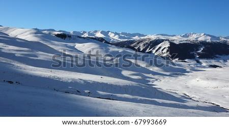 Panorama of winter mountains - stock photo