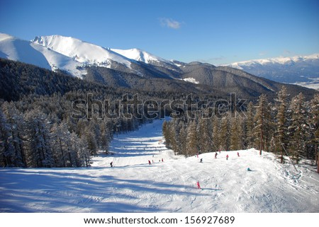 Panorama of winter mountains. Alpine ski resort Bansko, Bulgaria - stock photo