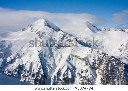 Panorama of winter mountains. Alpine ski resort Bansko, Bulgaria - stock photo