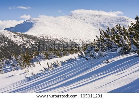Panorama of winter mountains. Alpine ski resort Borovets, Bulgaria - stock photo
