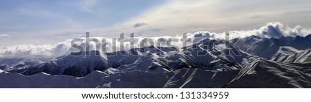 Panorama of winter mountains at sunset. Caucasus Mountains, Georgia, Gudauri. View from ski slope. - stock photo