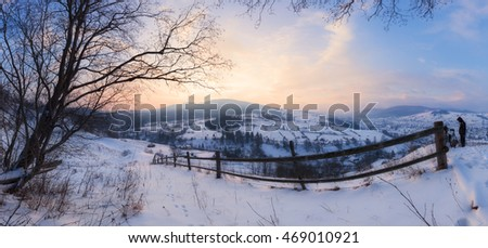 Panorama of winter mountains sunrise
