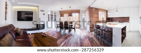 Panorama of wooden modern lounge connected with kitchen