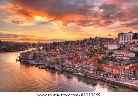 Panorama old city Porto at river Duoro,with Port transporting boats at sunset,  Oporto, Portugal - stock photo