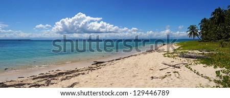 Panorama on an unspoiled beach with calm water in the Caribbean sea, Zapatilla island, Panama - stock photo