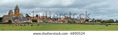 Panorama over a typical countryside village in Normandy - stock photo