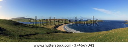 Panorama over the Bay of Scousburgh with Loch Spiggie, south Mainland, Shetland, Scotland, UK. - stock photo