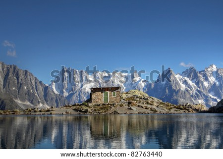 Panorama over the Mont Blanc Massif from the Lac Blanc (2352m), with the Grandes Jorasses (4208m), Dent du Geant (4013m) and on the right the 3 Aiguilles du Chamonix (3842m) - stock photo