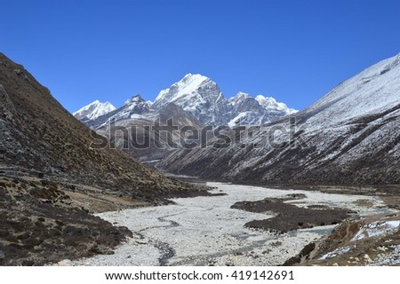Panorama over white mountain valley. Trek to Everest Base Camp, Nepal - stock photo