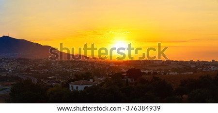 Panorama, panoramic view scene of sunset Over Mountains and town Mijas, Spain. - stock photo