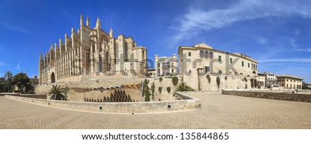 Panorama pf Cathedral of Majorca La seu and old city walls from Palma de Mallorca in Balearic Island Spain - stock photo