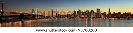 Panorama  photo of the San Francisco bay bridge and the city of SF.shot in the evening - stock photo