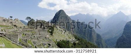 Panorama  photo of the UNESCO World Heritage Site Machu Picchu. Picture was taken in october 2014 - stock photo