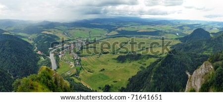 panorama photo taken from famous tourist destination - Three Crowns hills in Poland. Dunajec river dividing Poland and Slovakia in background. - stock photo