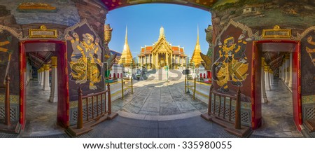 Panorama picture of Wat Phra Kaew, Temple of the Emerald Buddha with blue sky - stock photo