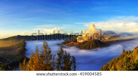 Panorama scene of Mount Bromo, active volcano during sunrise with  cloud, it's located in Bromo Tengger Semeru National Park, East Java, Indonesia. - stock photo