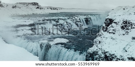 Panorama shot at Gulfoss Golden Falls waterfall Iceland in winter, with blue water and creative toning applied