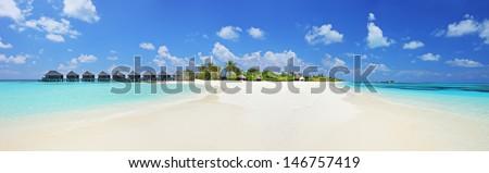 Panorama shot of a tropical island on Lhaviyani atoll, Maldives on a sunny day - stock photo