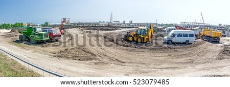 Panorama showing the group of construction machinery is parked at building site.