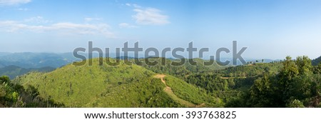 Panorama sky, forest and mountains. The natural abundance of forests of northern Thailand. - stock photo