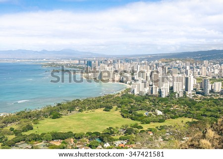 Panorama skyline view of Honolulu city and Waikiki beach in the pacific island of Oahu in Hawaii - Postcard from Diamond Head crater of exclusive travel destination - Sunny afternoon color tones