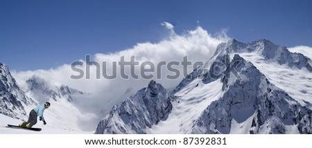Panorama snow mountains with snowboarder. Ski resort Dombay, Caucasus. - stock photo