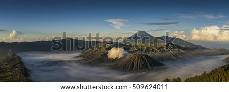 Panorama ,Sunrise at Mount Bromo volcano, the magnificent view of Mt. Bromo located in Bromo Tengger Semeru National Park, East Java, Indonesia.