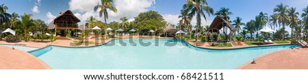 Panorama swimming pool of a luxurious tropical hotel - stock photo