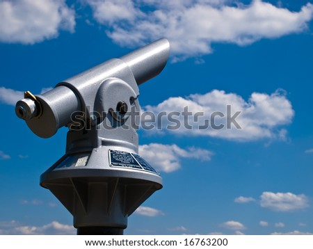 Panorama telescope pointing to the sky with clouds.