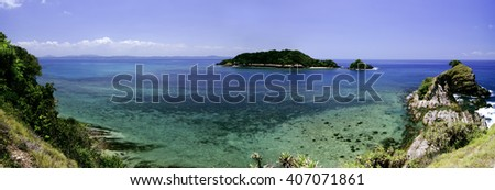panorama view from hill top at Kapas Island, Terengganu, Malaysia surrounded by crystal clear water, coral, island  and blue sky background.