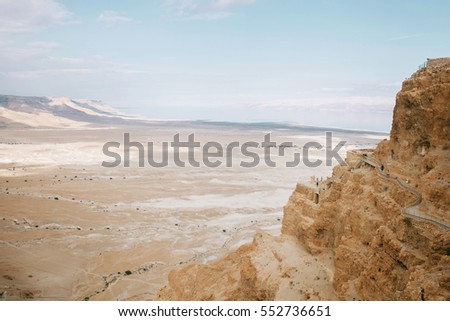 Panorama view from Masada fortress to a mountain valley and desert