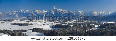 panorama view in bavaria, germany, to the alps mountains at sunny winter day