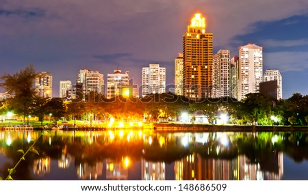 Panorama view of Bangkok city downtown with reflection of skyline at night