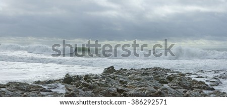 Panorama view of breaking waves from an incoming winter storm, Porthleven, Cornwall, England, UK