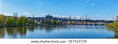 Panorama view of Charles bridge over Vltava river and Gradchany (Prague Castle) and St. Vitus Cathedral in the Prague, Czech Republic - stock photo
