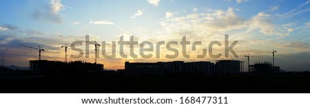 Panorama view of construction site during sunrise  - stock photo