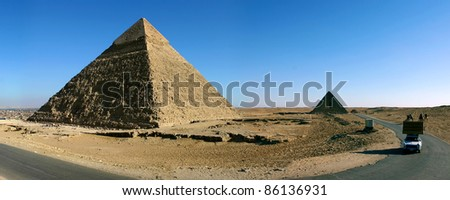 Panorama view of Giza pyramids with a clear blue sky, Egypt.