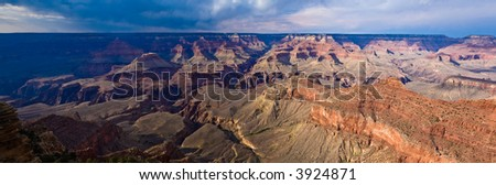 Panorama view of Grand Canyon late evening, storm clouds and shadows