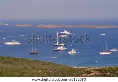 Panorama view of luxury yacths anchored in the wonderful scenery of Costa Smeralda - Sardinia - Italy - stock photo